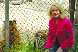 Tippi Hedren hanging with some big cats.