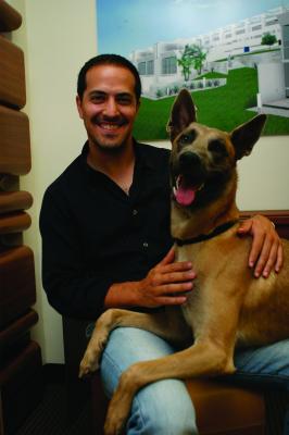 Sami Hayek and his dog Blue.