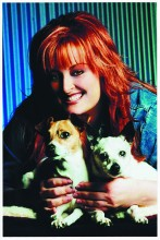 Winona Judd posing with two of her rescued dogs, she has adopted over 14 dogs in the past.