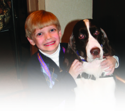 Noah Stutts joined by WKC Best in Show Winner, and Angel On A Leash therapy dog, James.