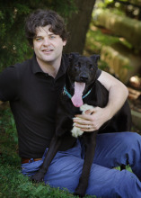 Dr. Brian Hare with his shelter rescue clever canine, Tassie.