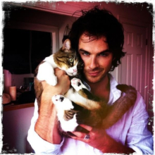 Ian and one of his cats.