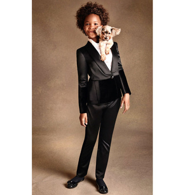 Quvenzhané Wallis poses with a pup for Armani Junior