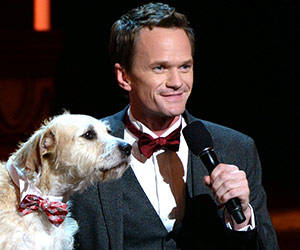 Tony's host Neil Patrick Harris gets some puppy love on stage!
