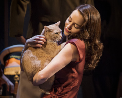 Emilia Clarke, star of Broadway's adaptation of Breakfast at Tiffany's, holds her feline costar.