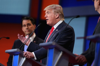 CLEVELAND, OH - AUGUST 06:  Republican presidential candidates Wisconsin Gov. Scott Walker (L) and Donald Trump participate in the first prime-time presidential debate hosted by FOX News and Facebook at the Quicken Loans Arena August 6, 2015 in Cleveland, Ohio. The top-ten GOP candidates were selected to participate in the debate based on their rank in an average of the five most recent national political polls.  (Photo by Scott Olson/Getty Images)